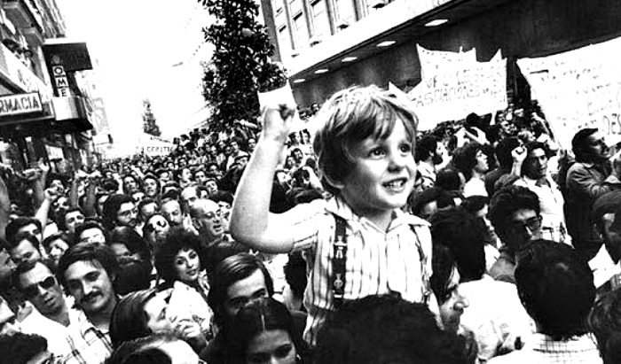 boy in streets during spanish transition to democracy